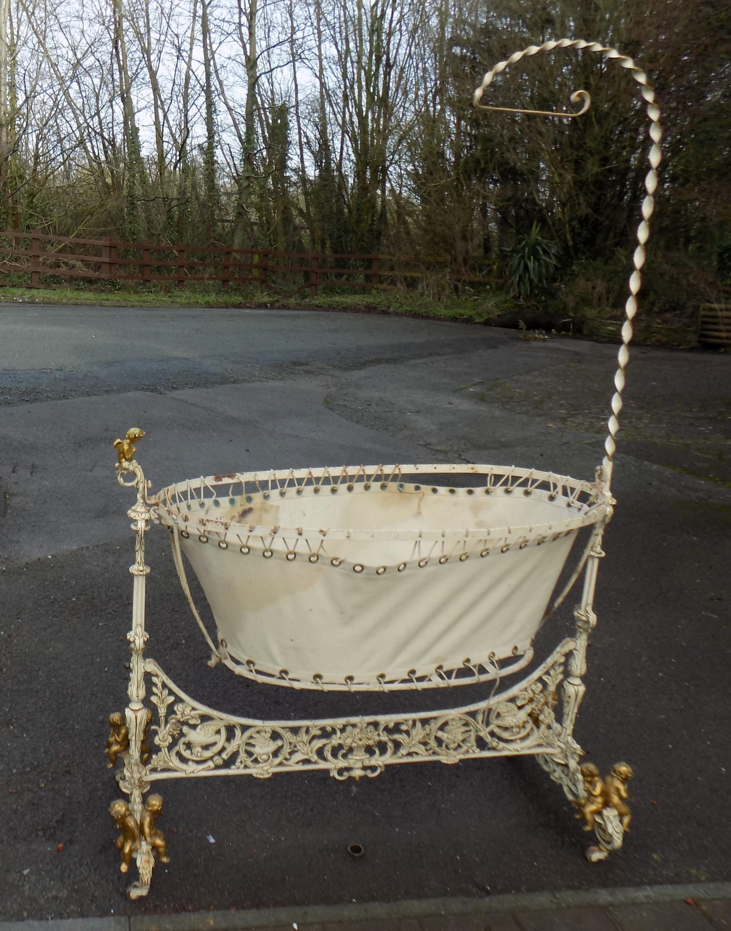 19th century cast iron rocking cradle