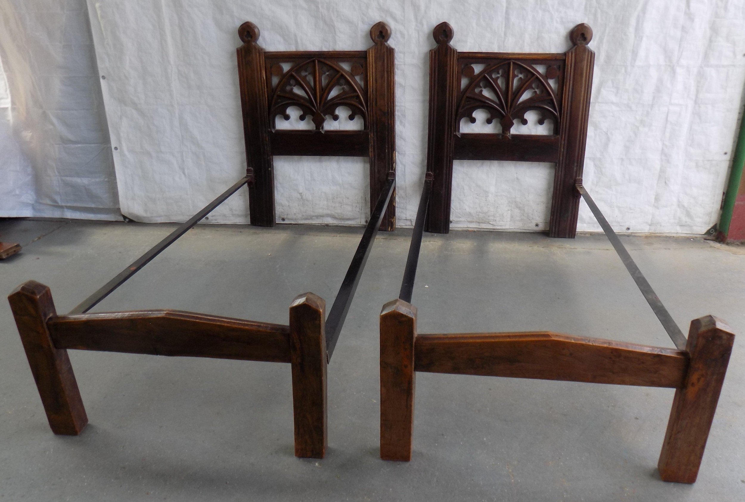pair of victorian gothic style oak bedsteads