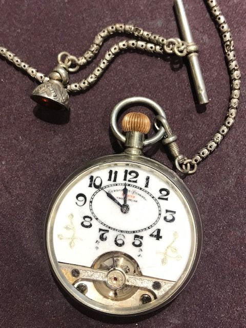 silver hebdomas pocket watch