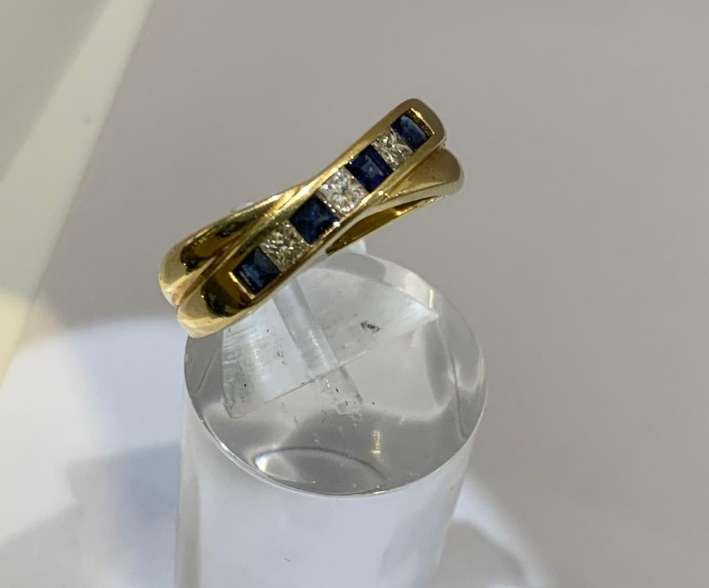 18ct diamond sapphire crossover channel set ring