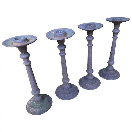 set of four french 18th century cast iron church pricket candle sticks