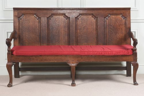 a large 18th century oak settle in superb condition