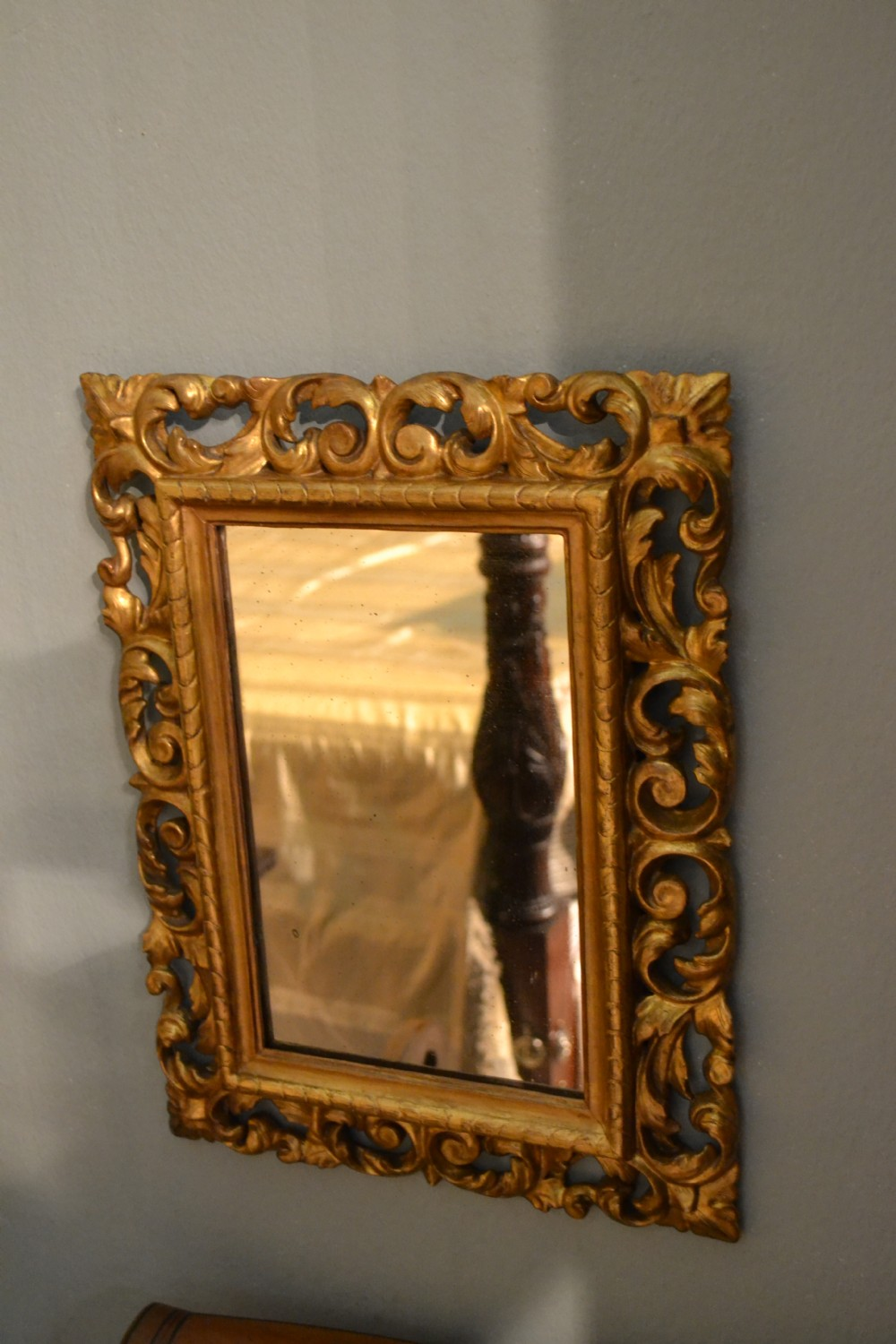lovely small hand carved and water gilded 19th century decorative mirror with original mercury plate in immaculate condition