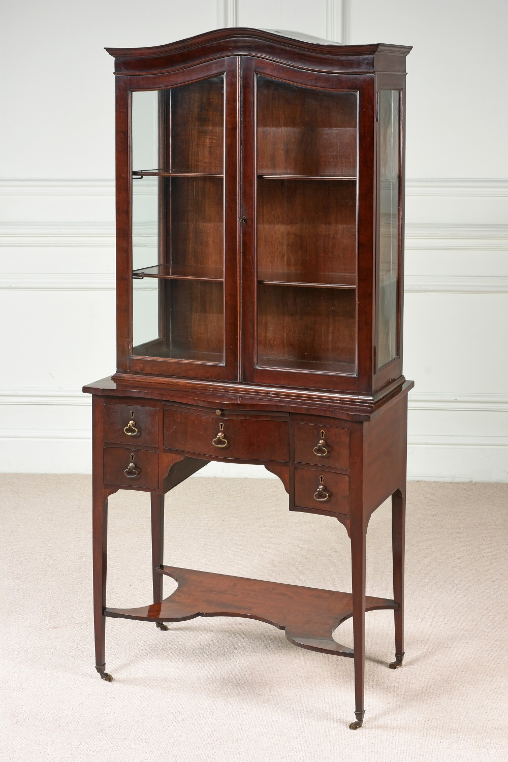 a beautiful small glazed cabinet on stand