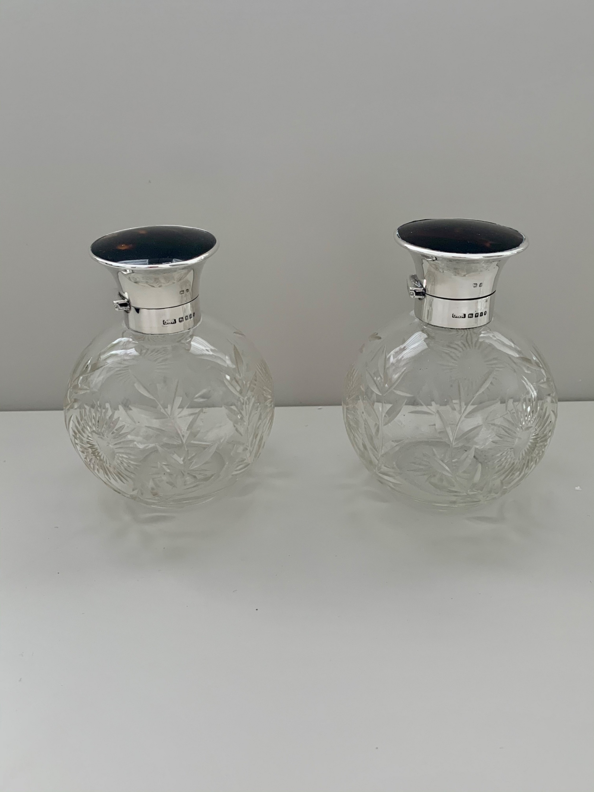 a pair of silver and tortoiseshell scent bottles hallmarked london 1934