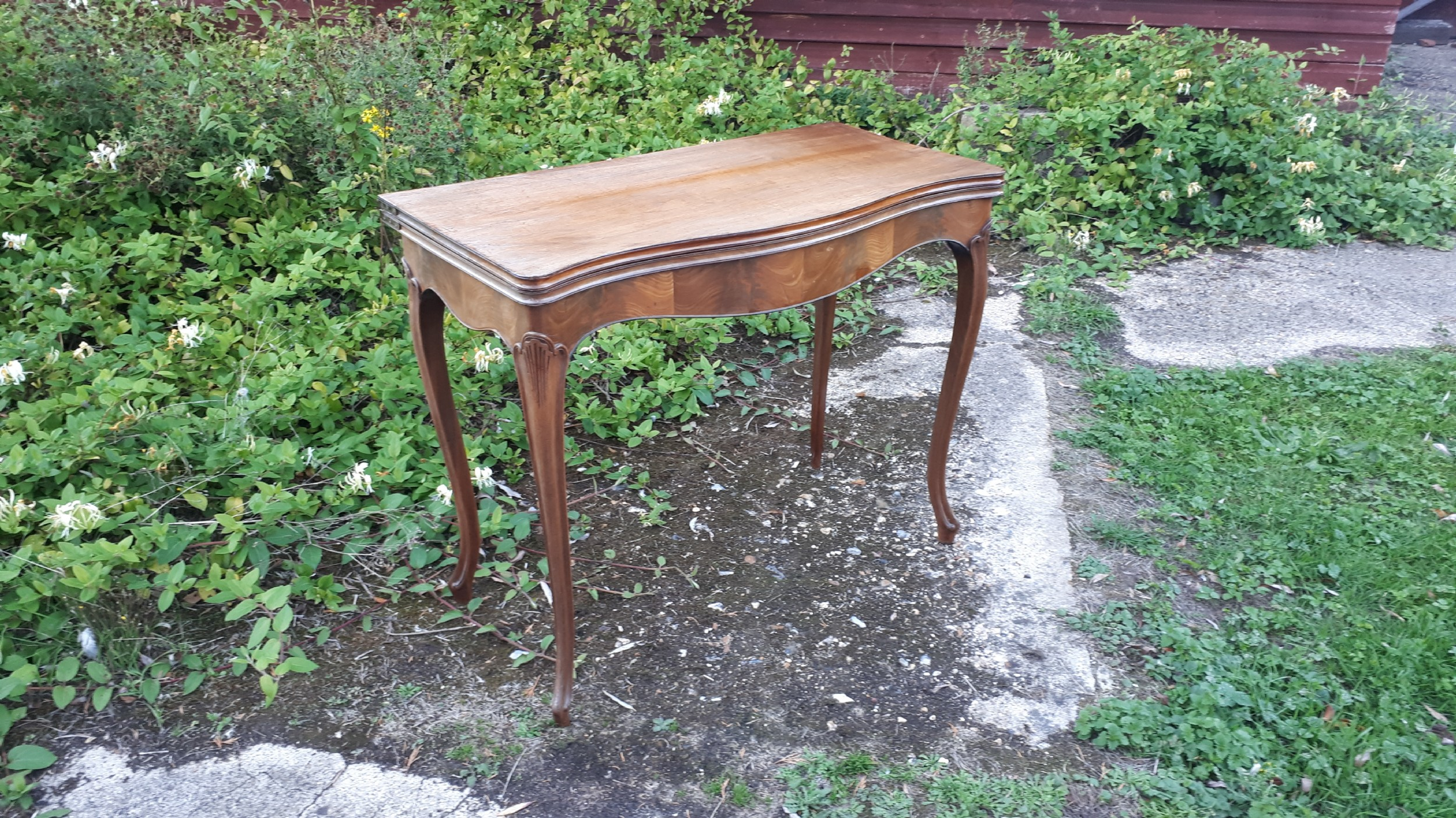 19th century serpentine front card table