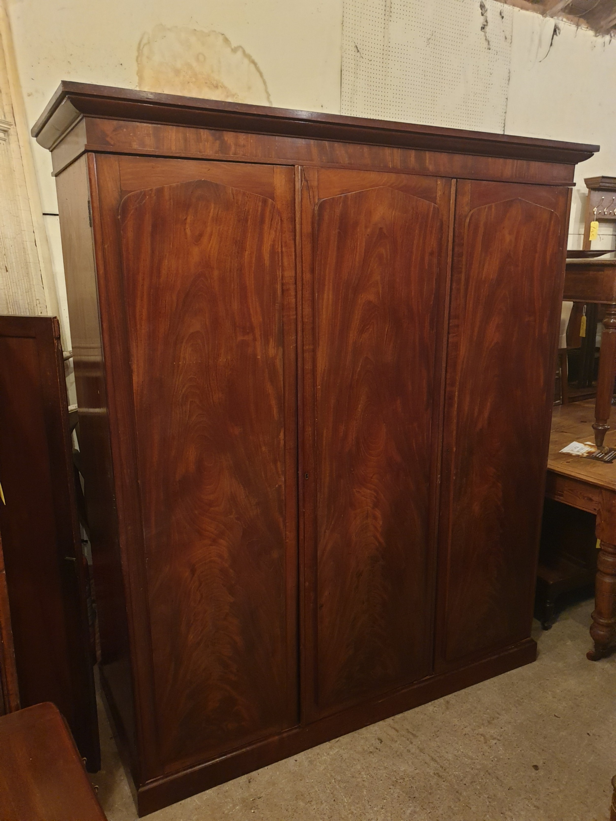 neat and practical early victorian 3 door fitted wardrobe