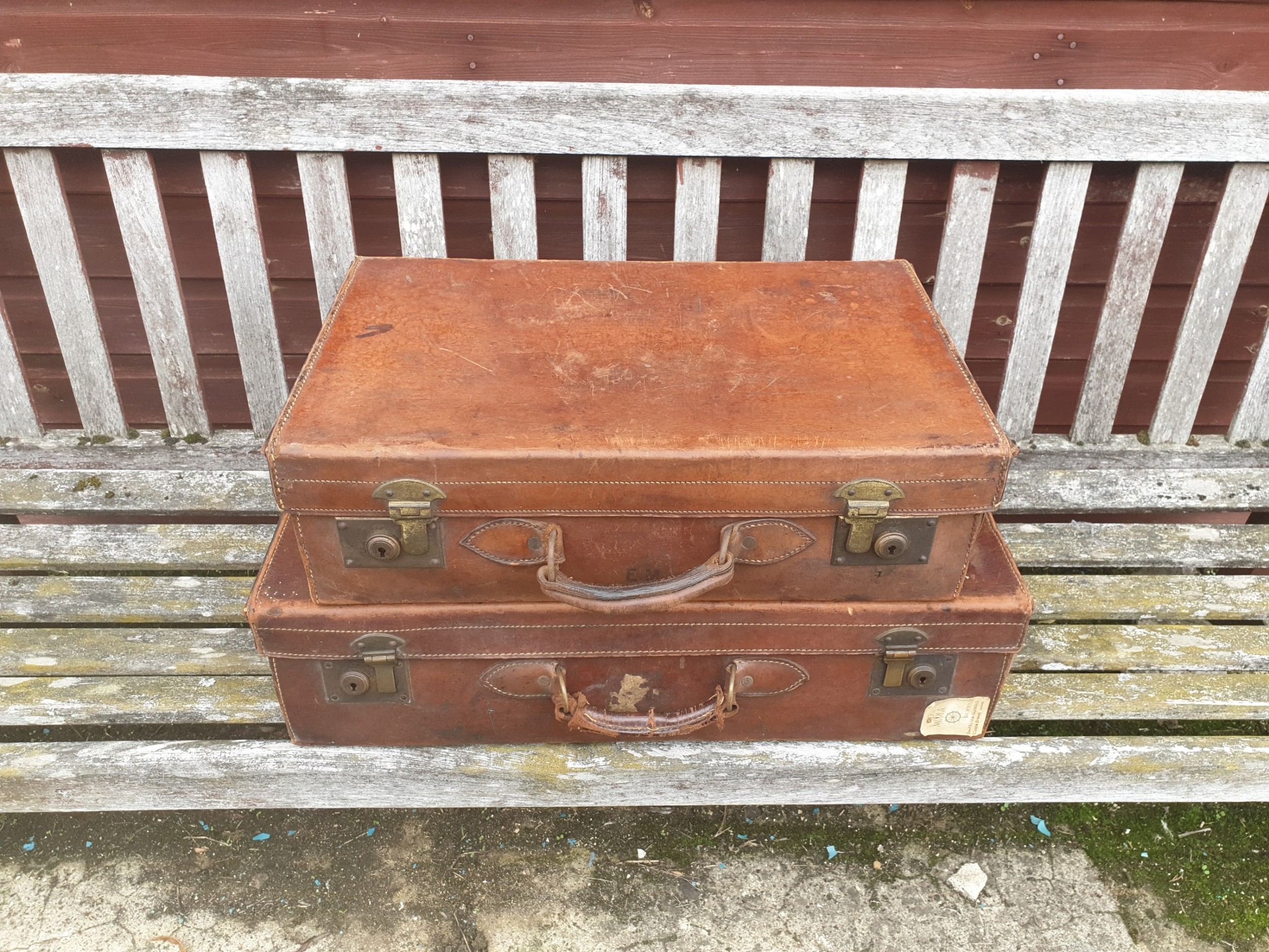 2 leather suitcases