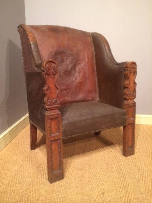 a very interesting walnut and part leather 18th century armchair