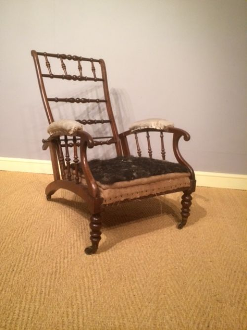 a 19th century walnut reclining country house armchair