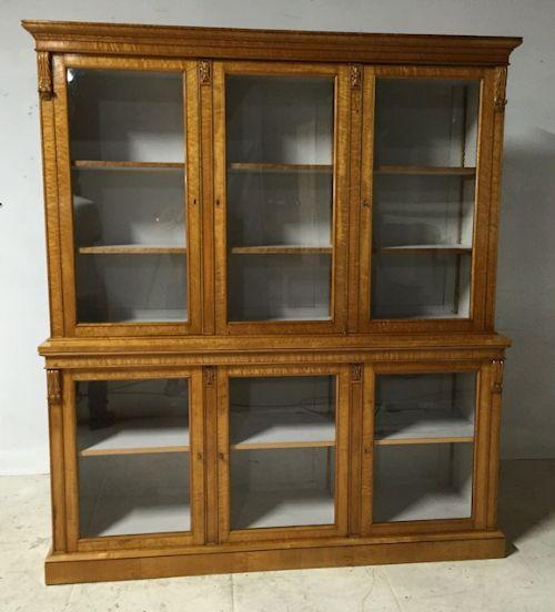 a 19th century birds eye maple sixdoor glazed bookcasedisplay cabinet