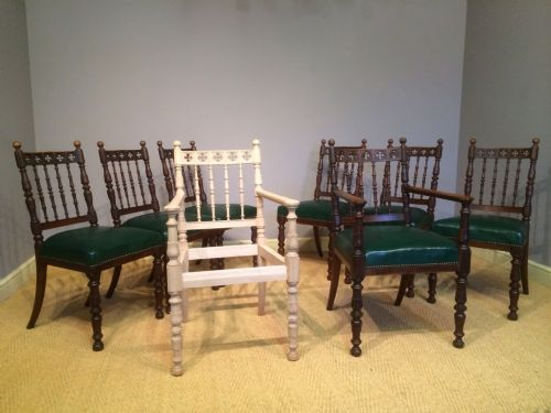 a set of eight gothic oak dining chairs