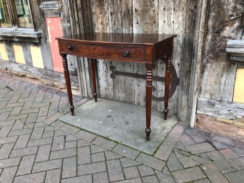 an early 19thc mahogany bow fronted single drawer side table