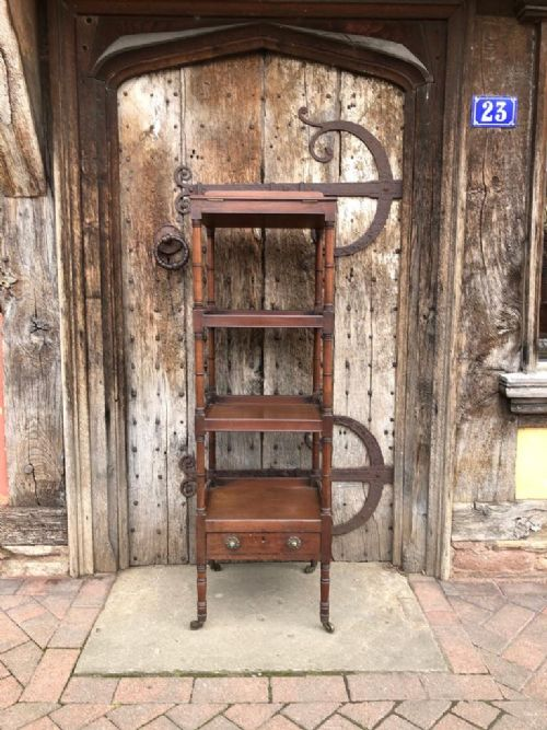 early 19thc mahogany four tier whatnot with adjustable reading stand
