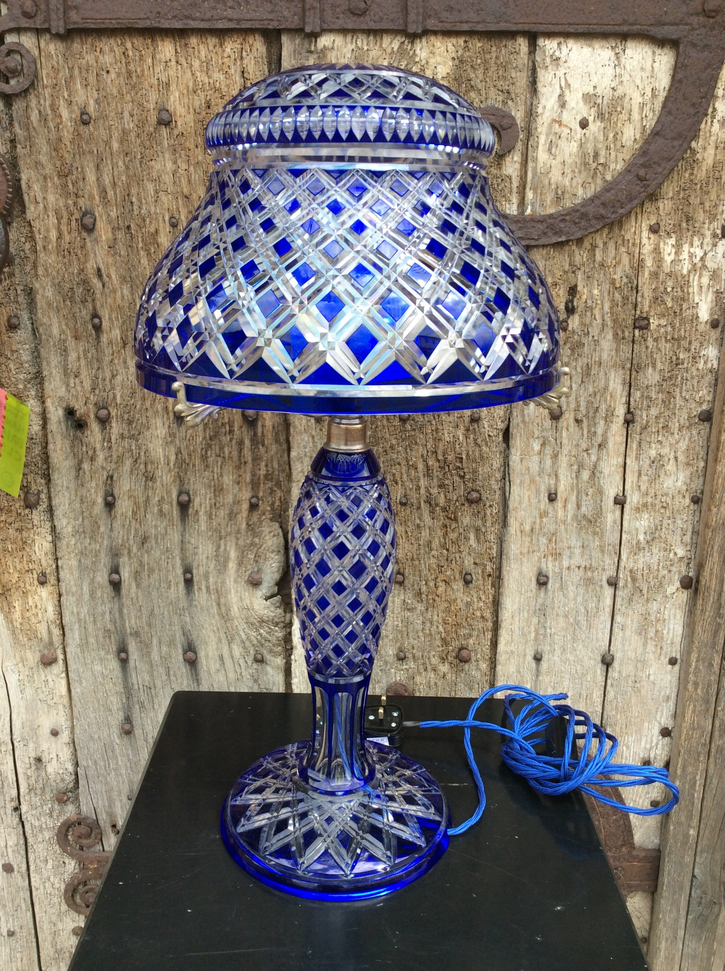 a blue overlay cut glass table lamp