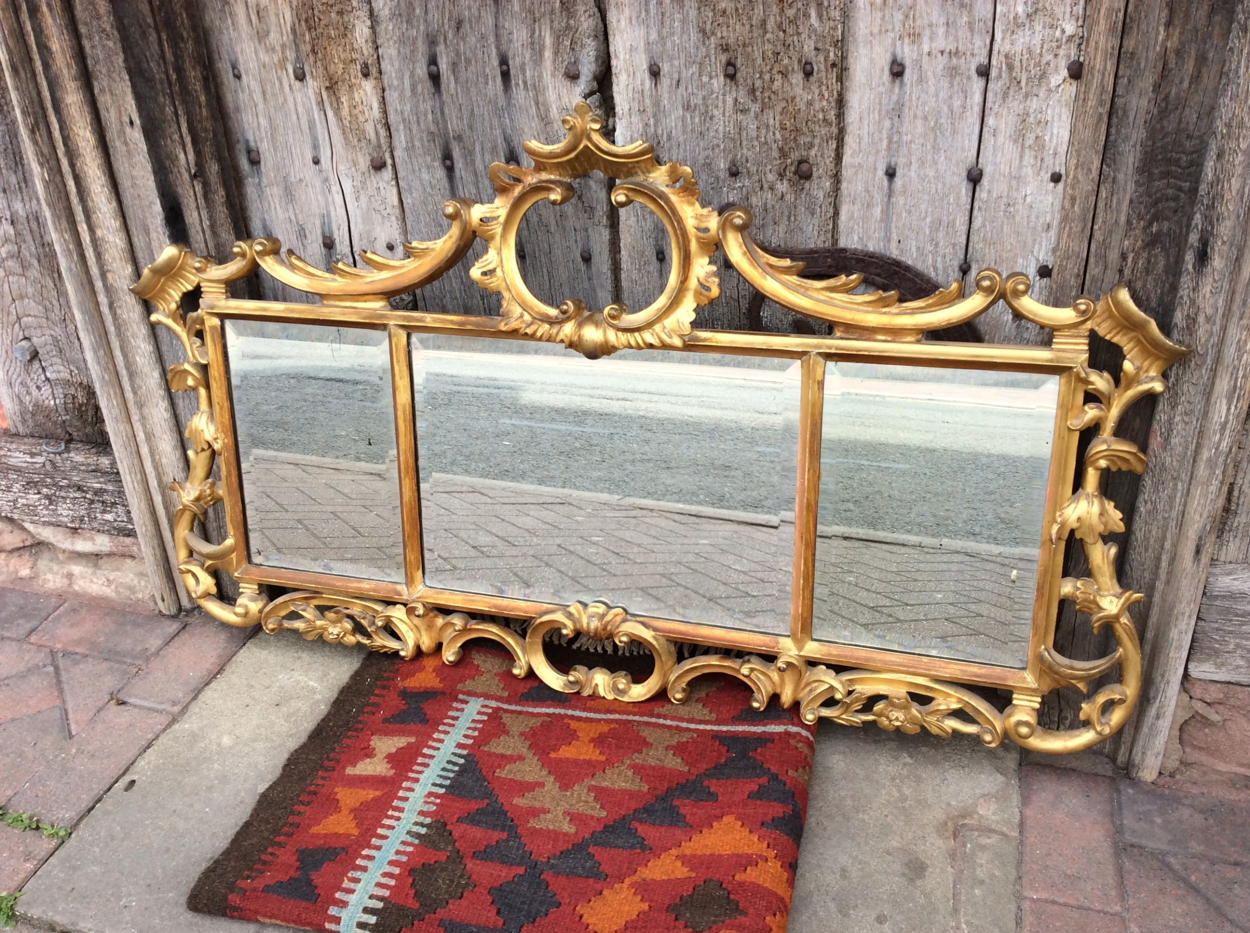 a 3 section gilded mirror