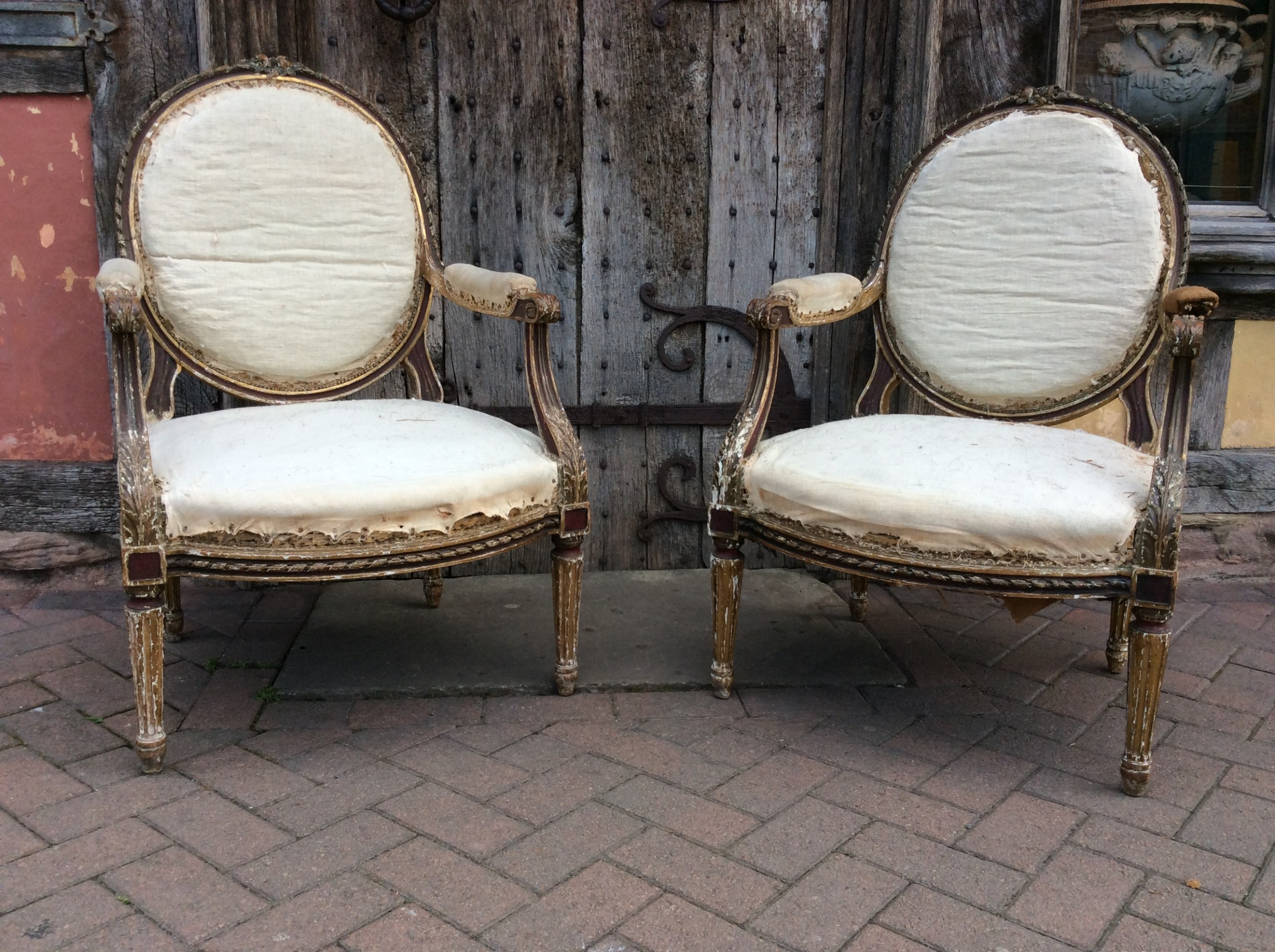a pair of 19thc french country house elbow armchairs