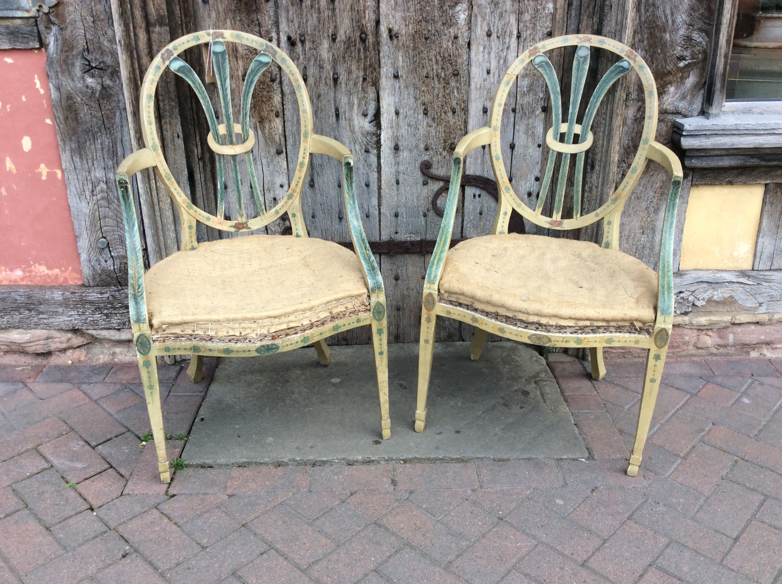 pair of 19th c painted open arm armchairs with prince of wales feathers shaped back