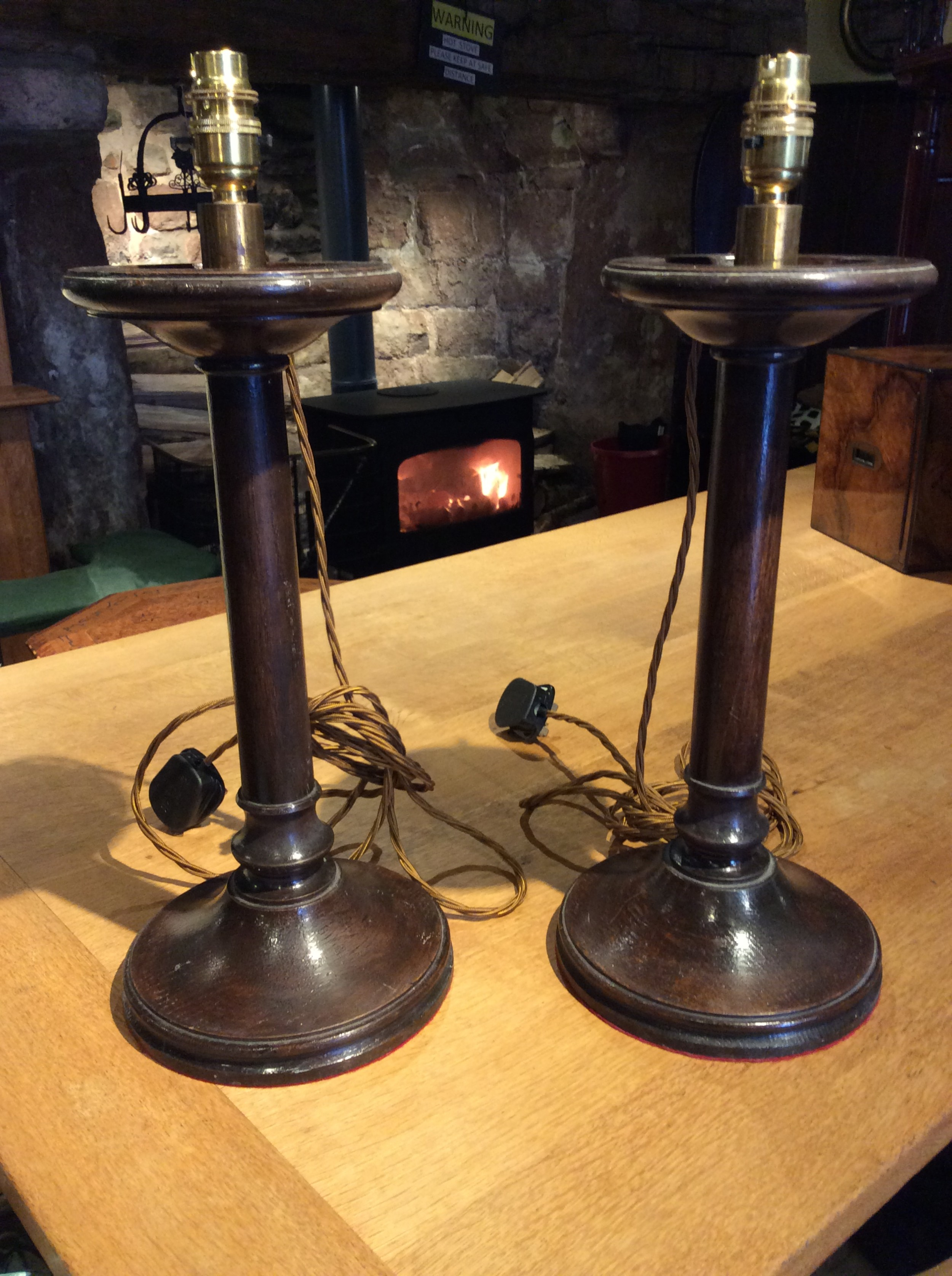a pair of edwardian candlestick oak lamps