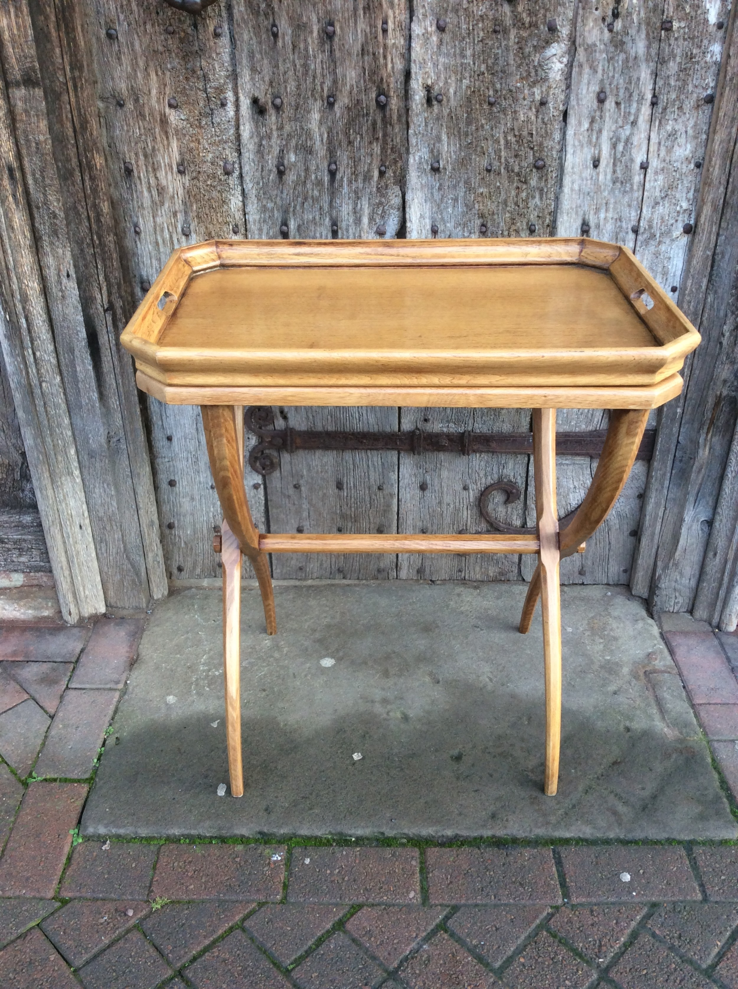 an early 20thc light oak buttlers tray with its stand