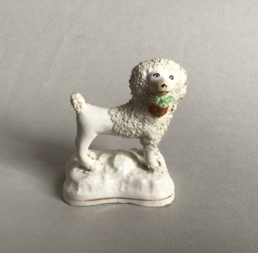 staffordshire poodle figure with basket of flowersc1840
