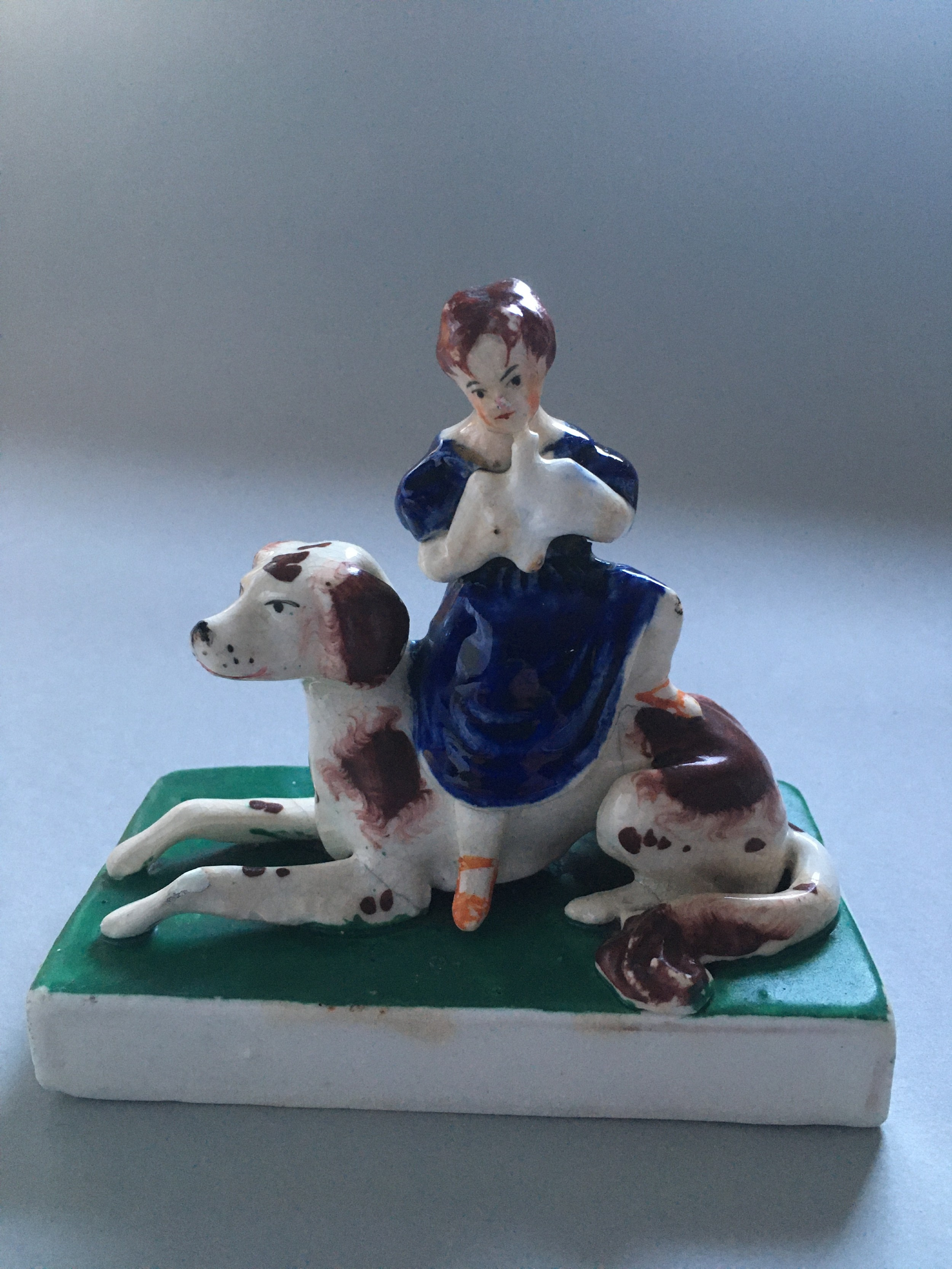 staffordshire figure of dog with child c1845