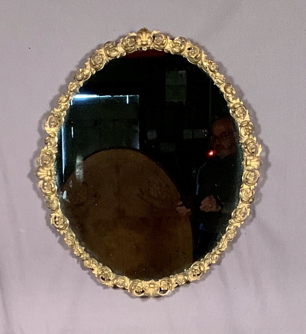 decorative nineteenth century gilt gesso oval mirror