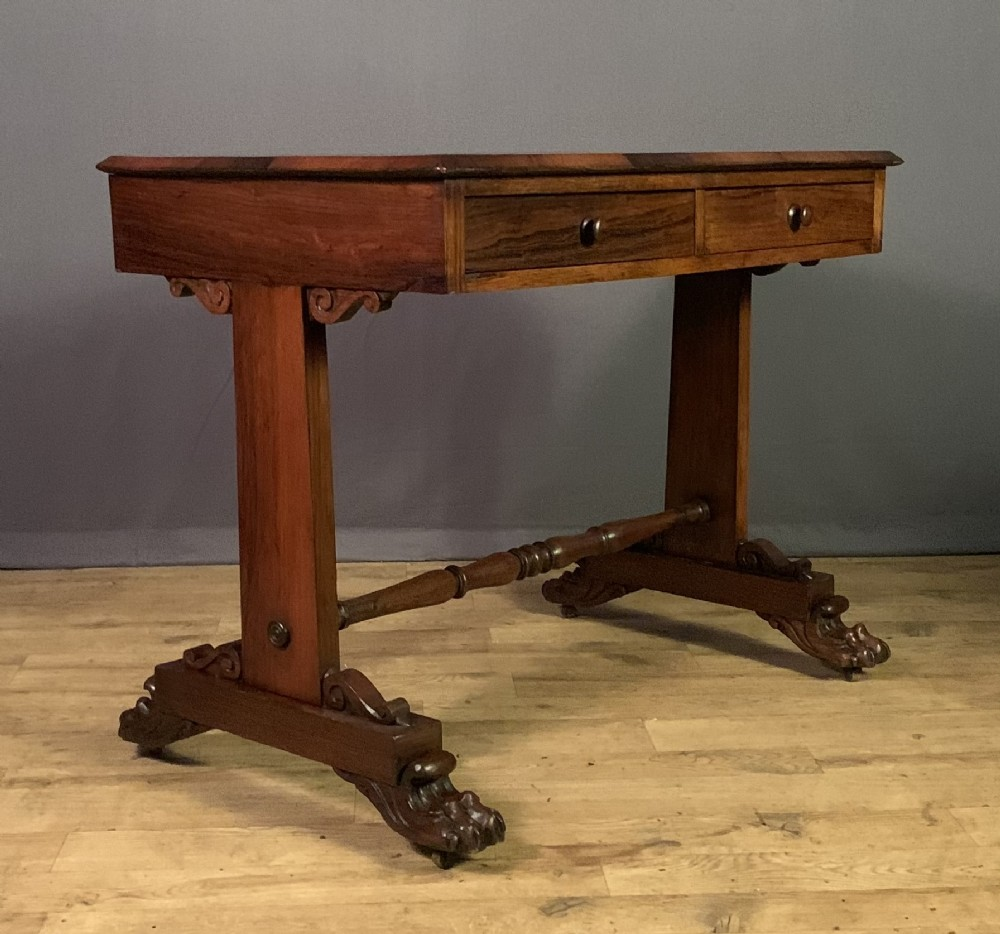 a late regency period rosewood two drawer library writing table
