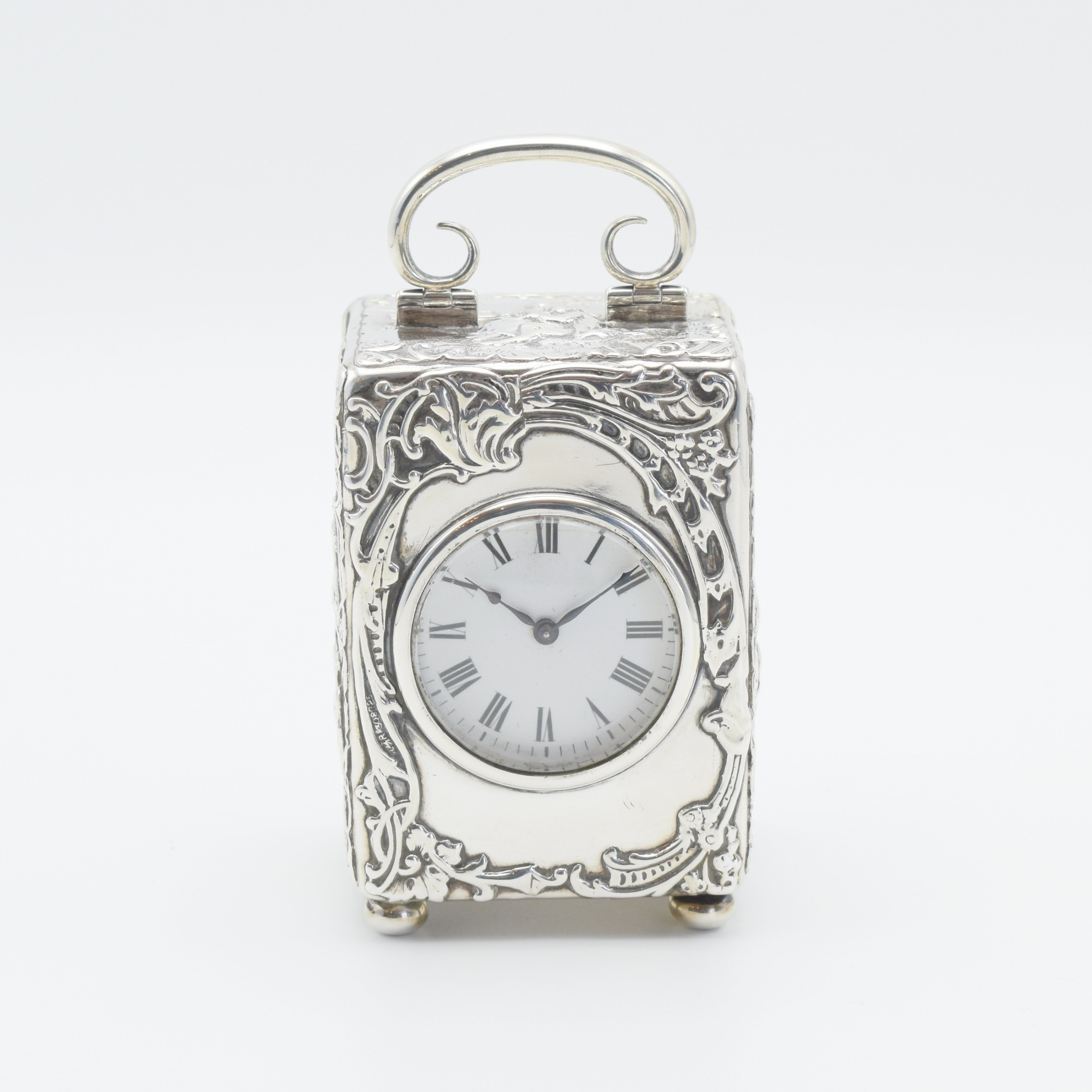 large silver 'repousse' carriage clock timepiece