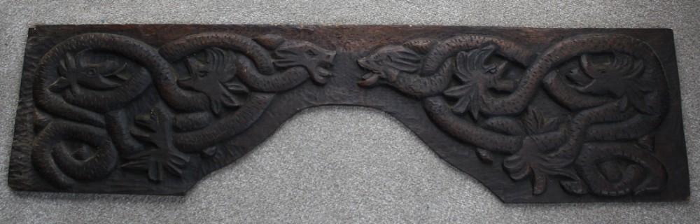 primitive carved oak panel of serpents 17thc