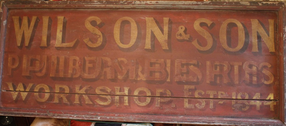 wooden c19th trade sign wilson son plumbers 1844