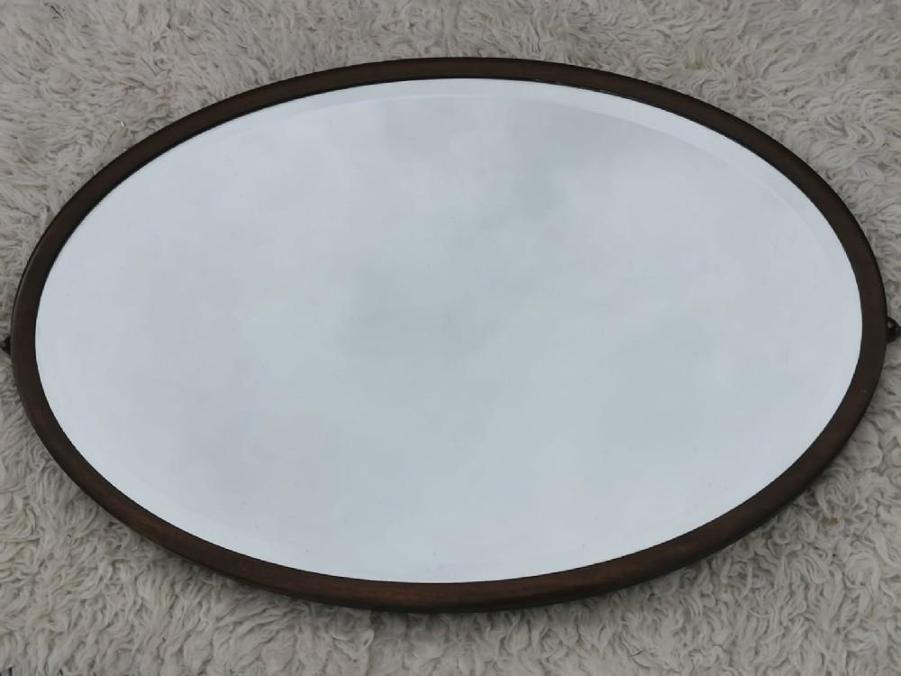 a fine edwardian oval mahogany mirror