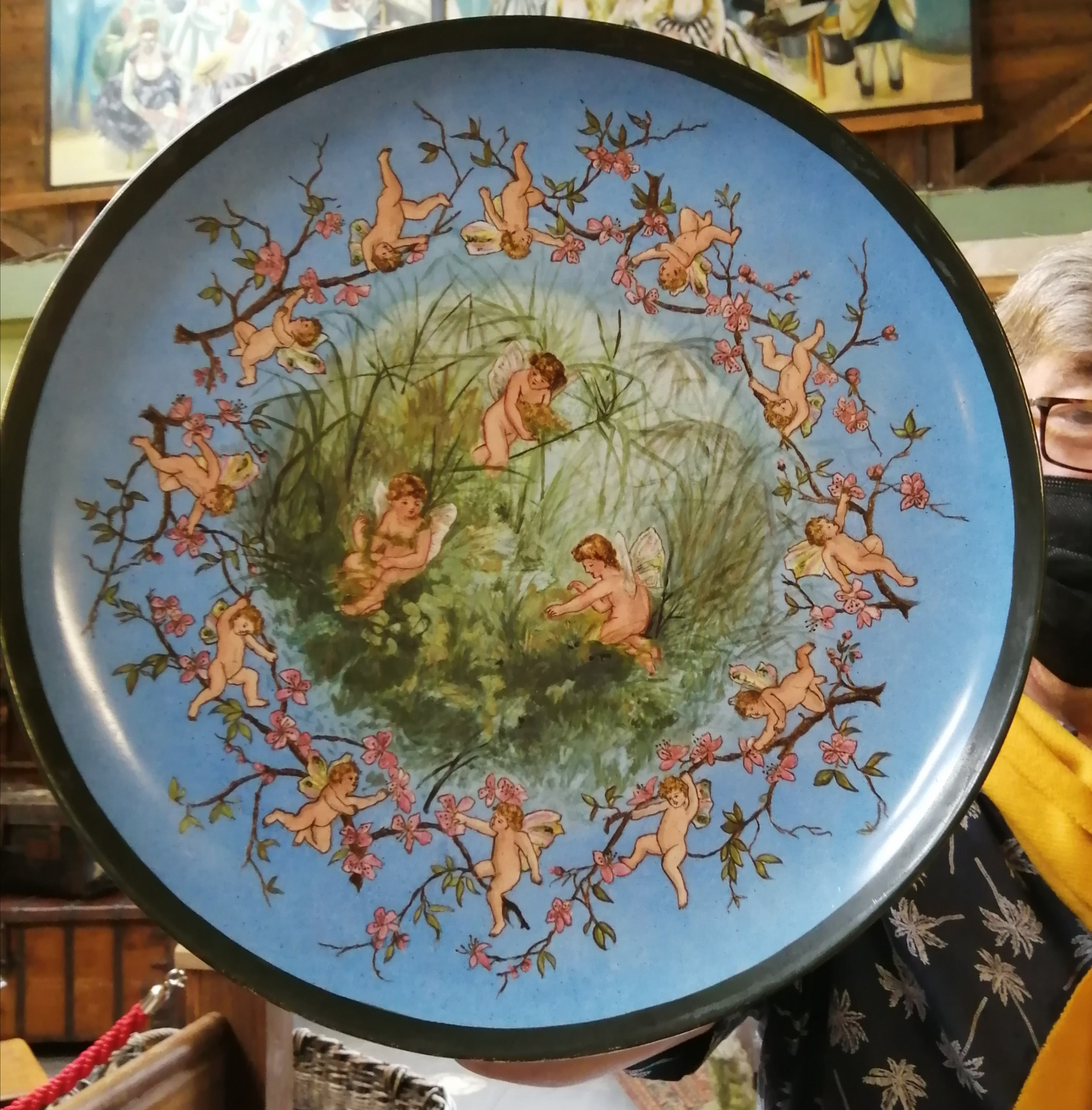 victorian pottery charger depicts cherubs at play