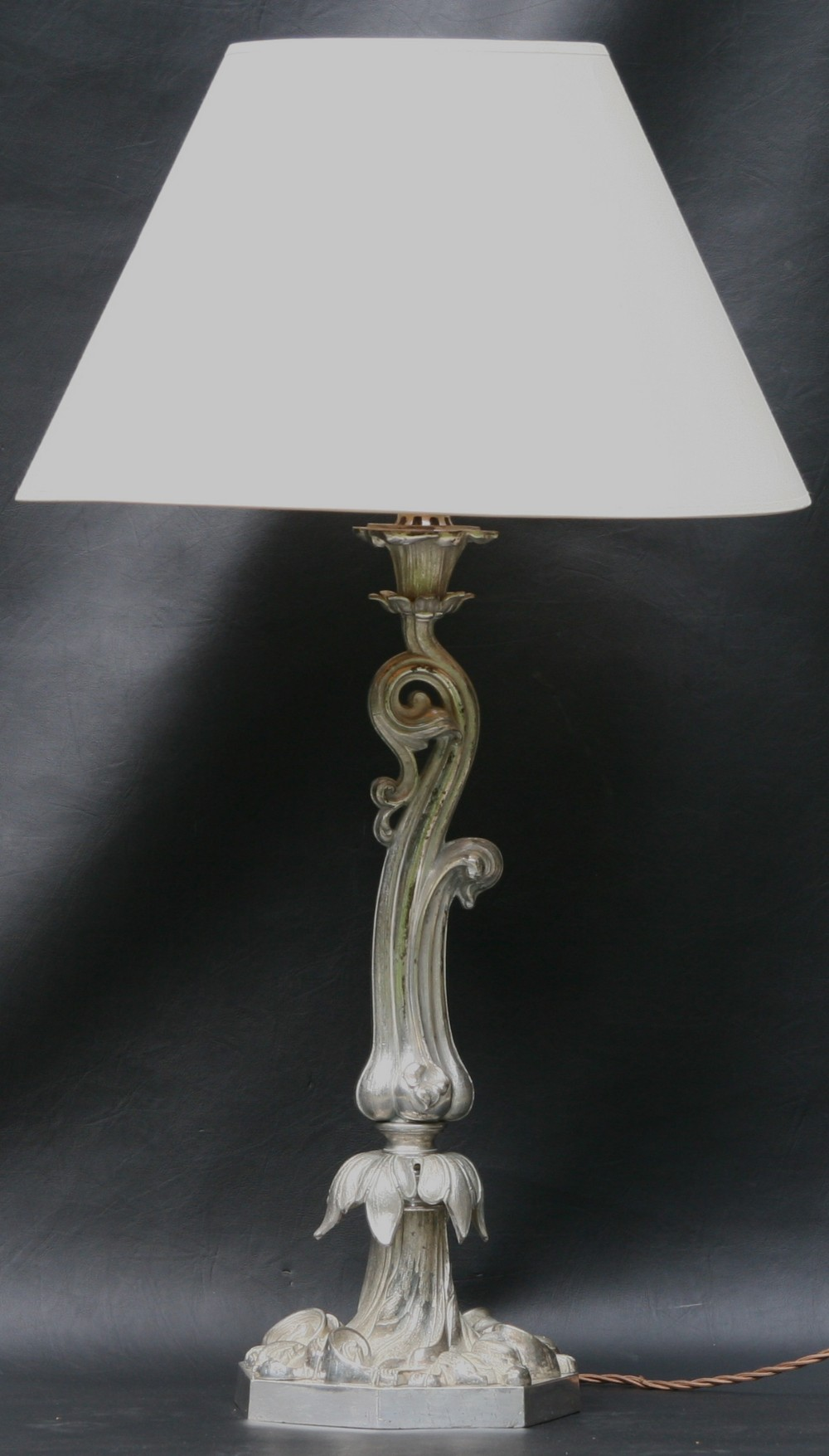 an early victorian silver plated oil lamp base converted to electricity