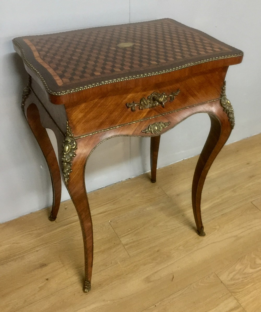 nineteenth century french work table with parquetry top and ormolu mounts