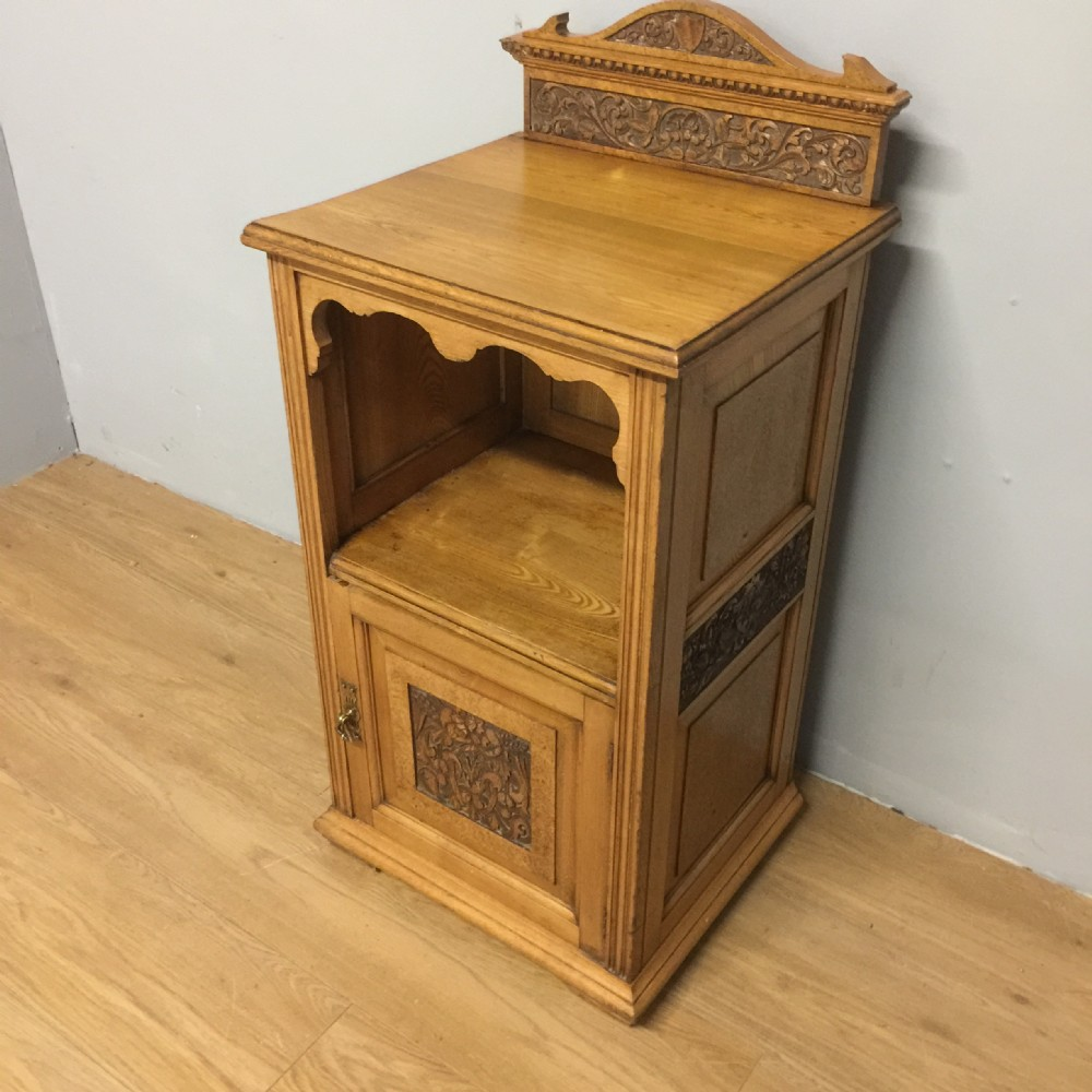 nineteenth century ash bedside cabinet with carved panels