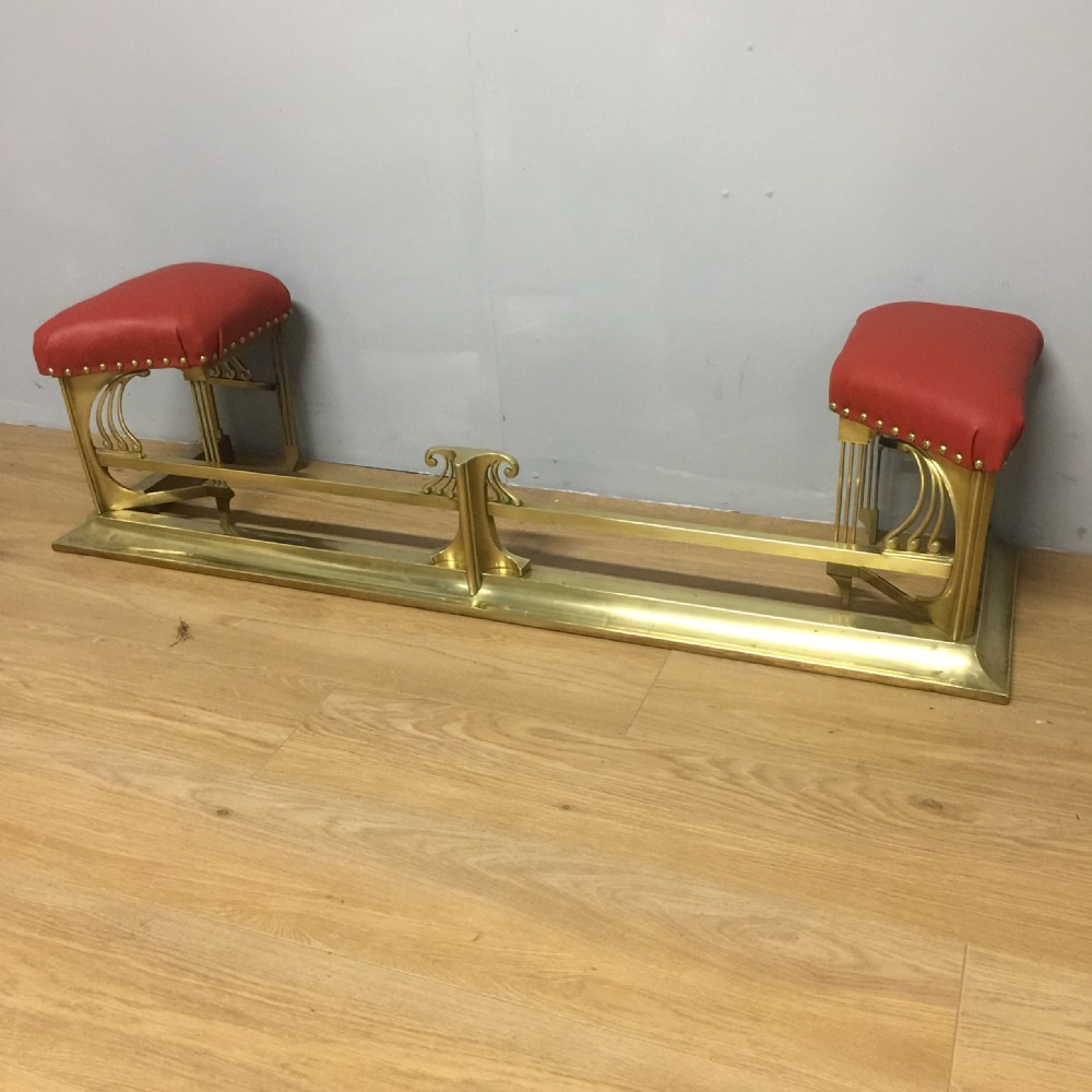art nouveau solid brass club fender with red leather seats