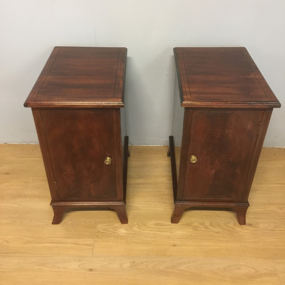 pair of edwardian inlaid mahogany bedside cabinets on splayed feet
