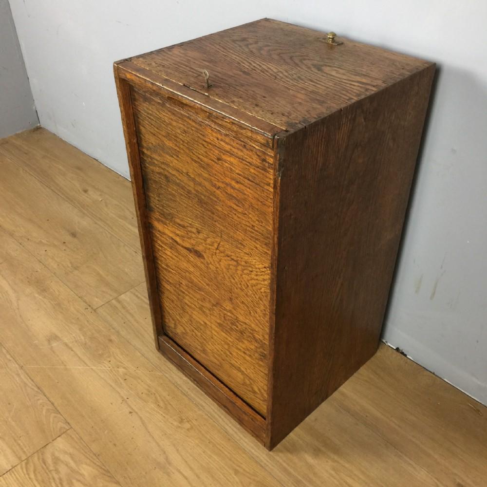 tambour fronted oak filing cupboard circa 1920