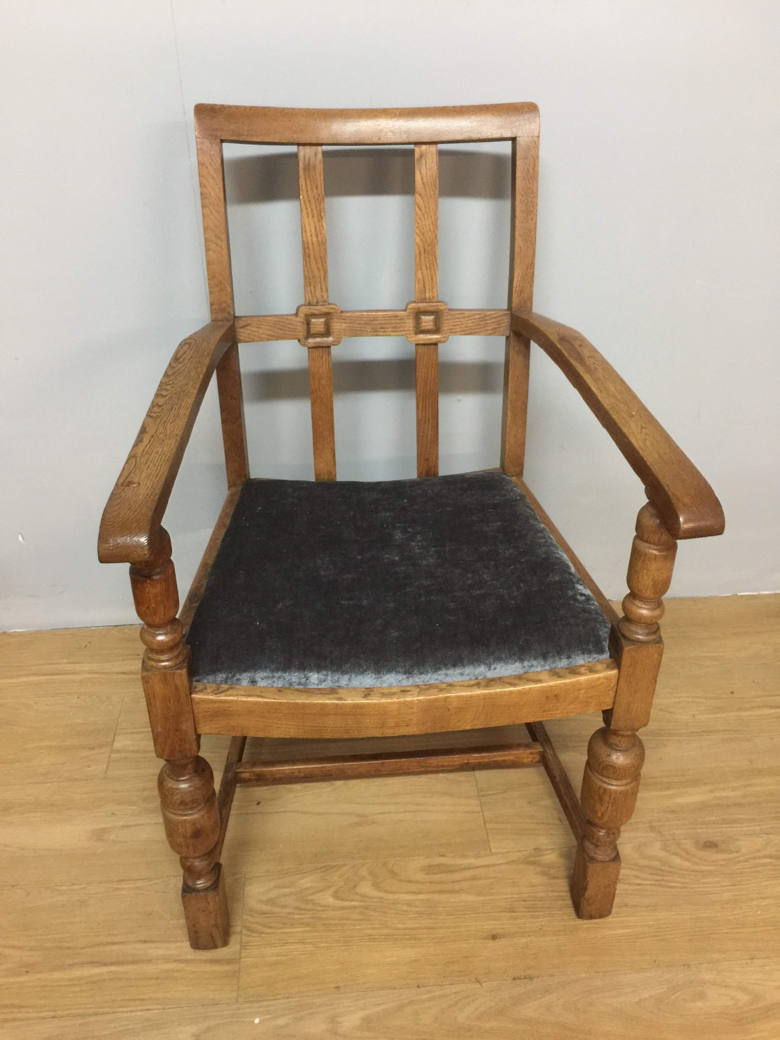 arts and crafts golden oak armchair from a masonic lodge