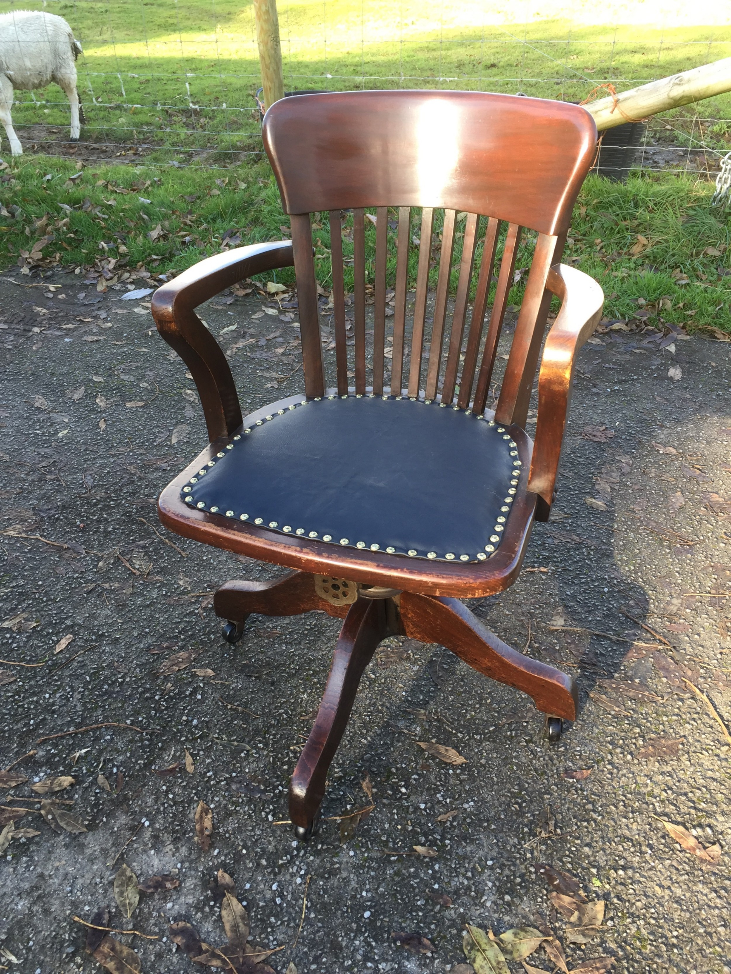 slat back swivel office chair with leather seat circa 1920