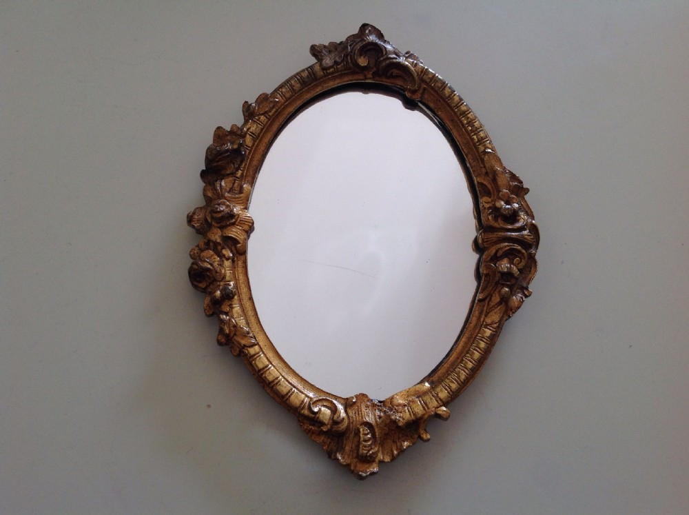 A small ormolu hanging wall mirror c1860 365065 for Small hanging mirror