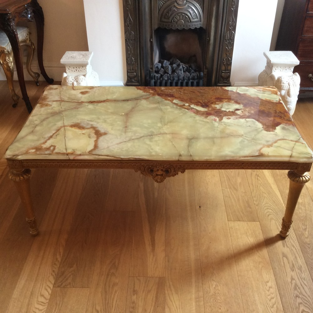 tablegilded carved wood and gilded gesso table with 1piece onyx top 1920's