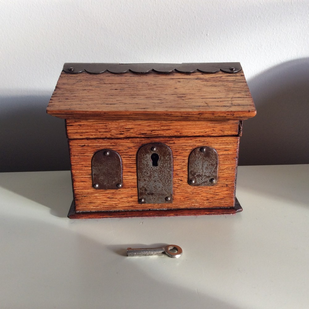 money boxblack forest oak and metal money box in the style of an alpine cabin c1870