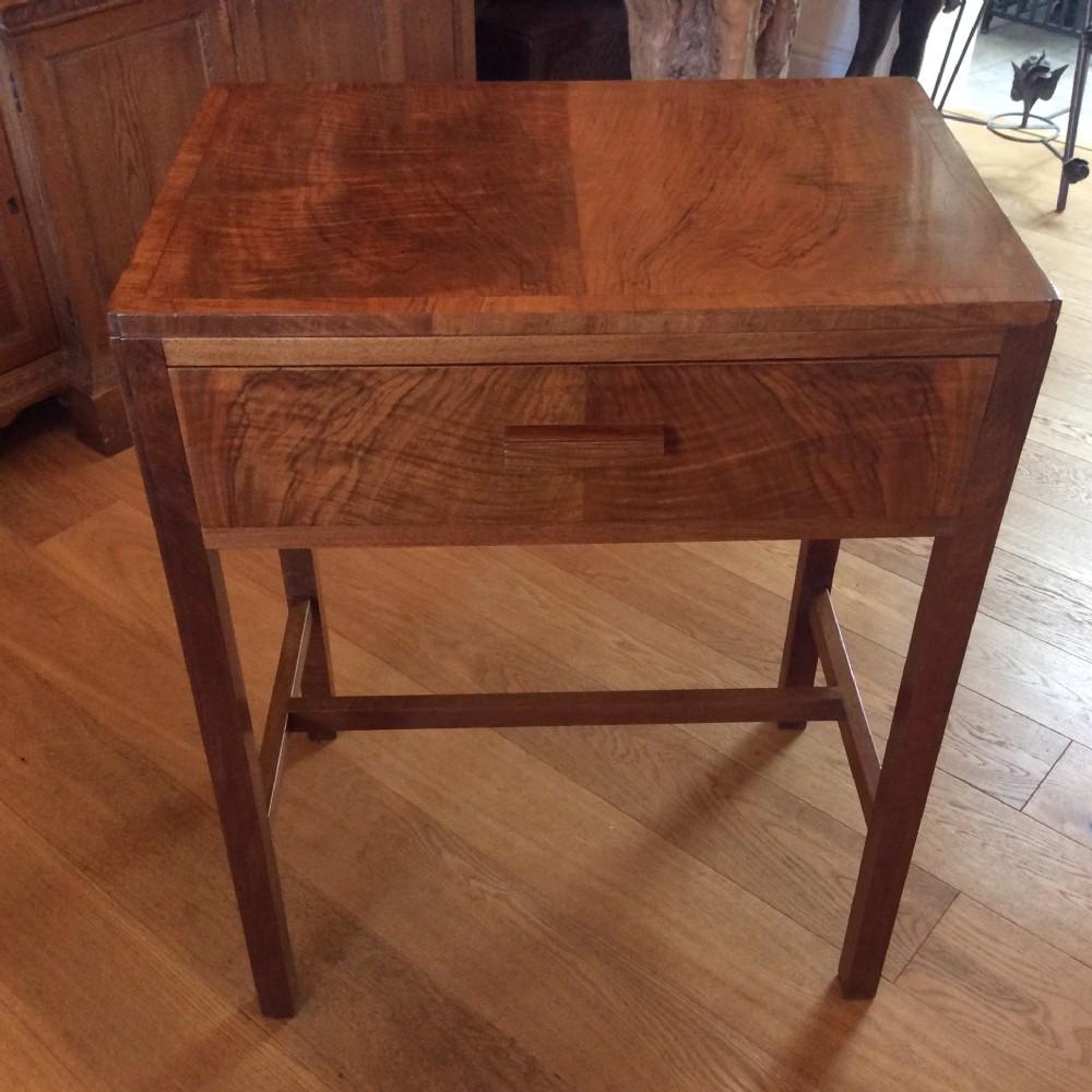 an art deco table in figured walnut c1930