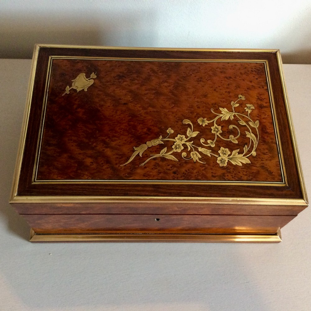 large jewellery boxpalais royal amboyna with rosewood bandinginlaid with brass original silk lining c1870