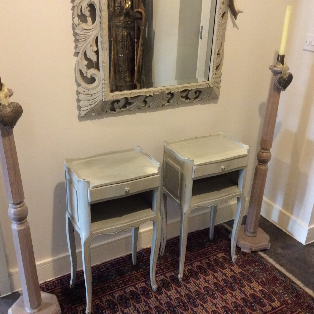 a pair of french painted bedside cabinets c 910