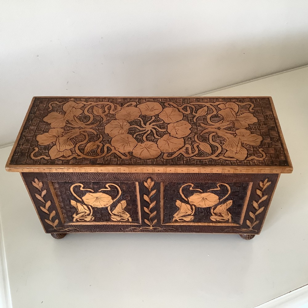 art nouveau box cofferin satin birch carved with lillies four bun feet c1890