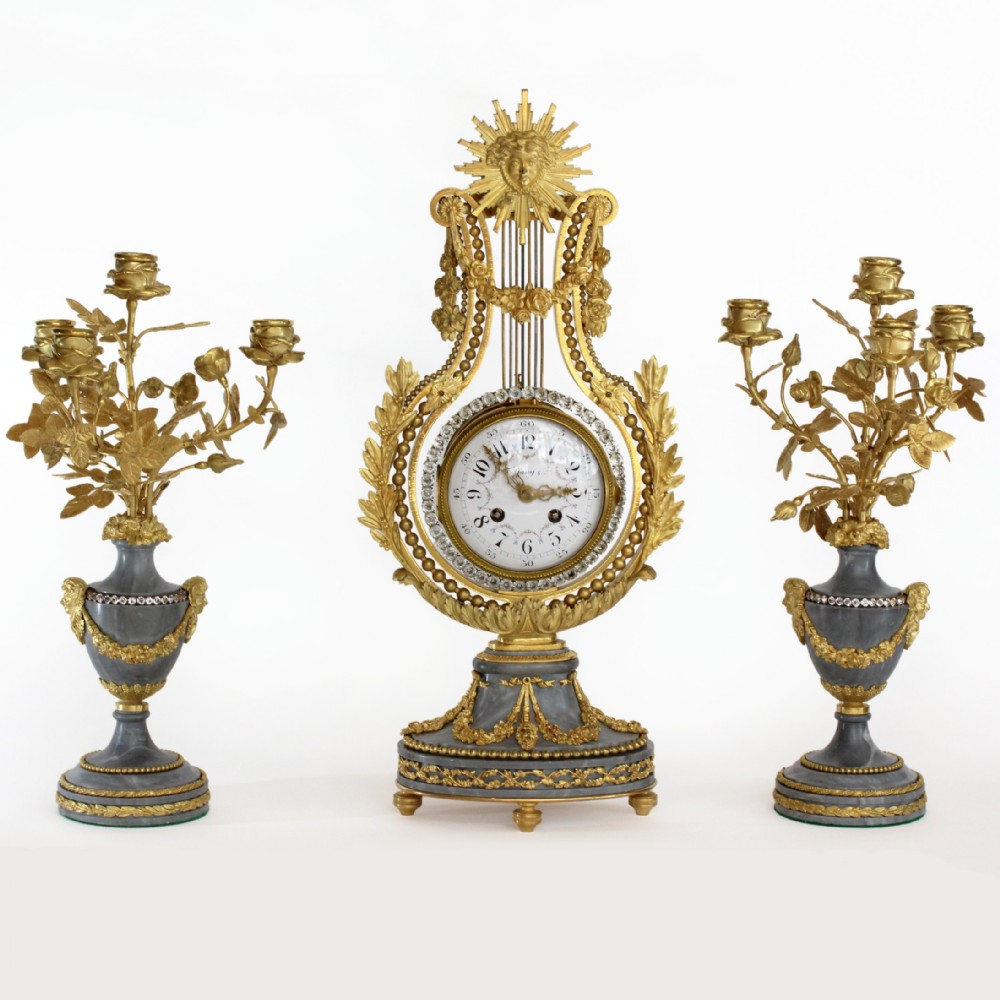 french gilt lyre clock pair of candelabra