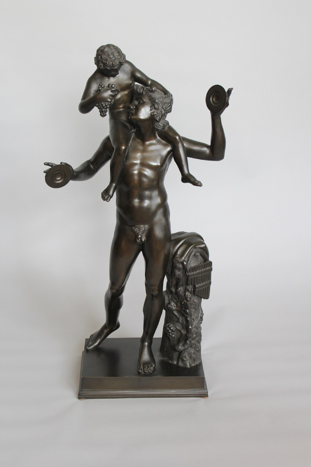 bronze of a faun with the infant bacchus